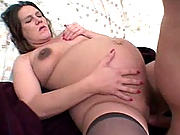 Knocked-up bitch with huge nipples filling her cunt with huge cock.