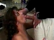 Pregnant milf sucks cock on kitchen